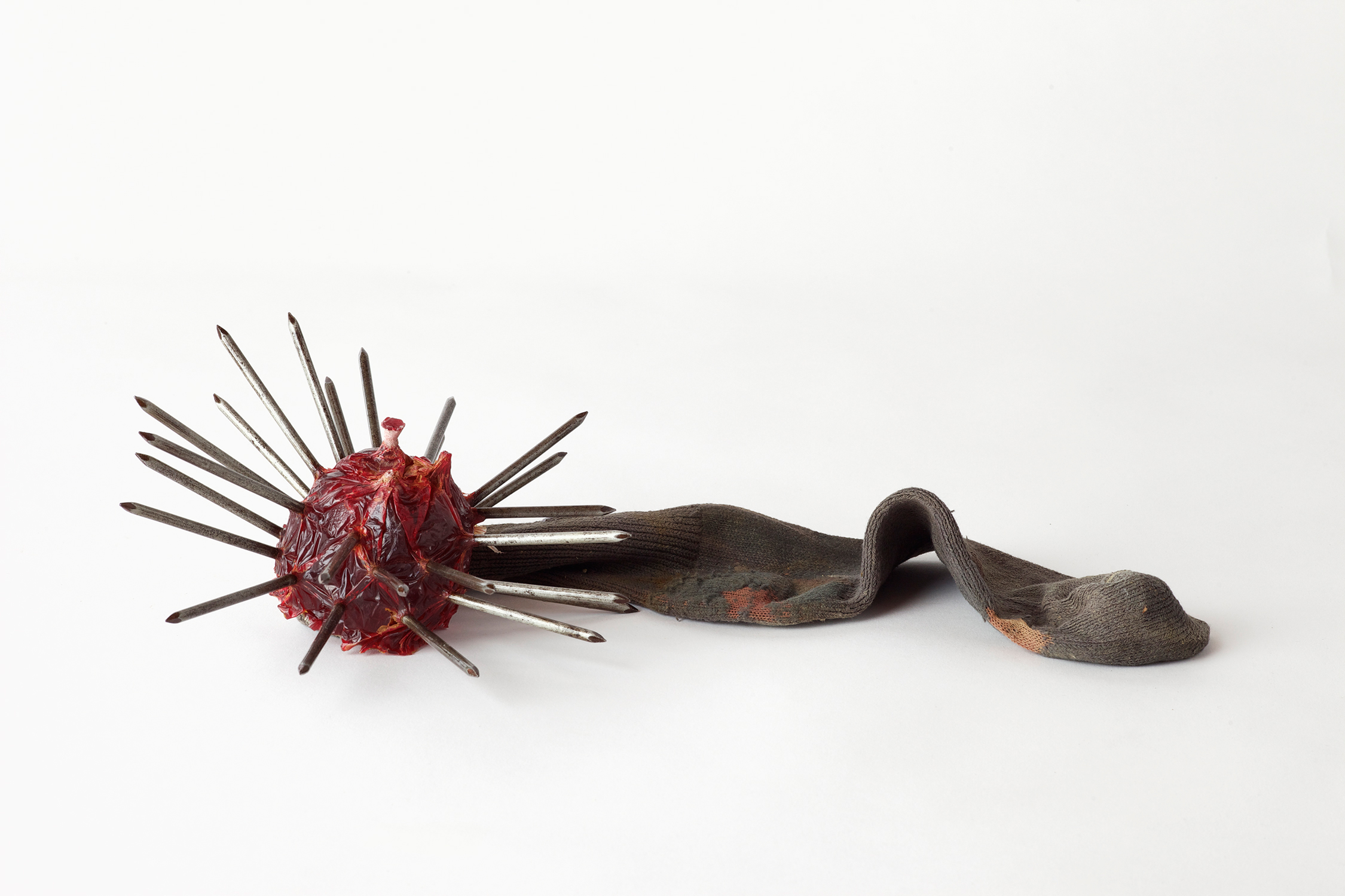 Emergency-Weapon-#21-(red-with-brown-sock)_2002_7'W-x-12'L-x-6'H_sock,-dirt,-urethane-resin,-nails