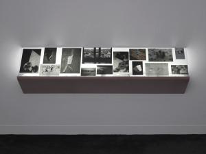 Tris Vonna-Michell Addendum I (Berlin), 2014 Lightbox shelf montage installation consisting of backlit photographic prints Courtesy of the artist